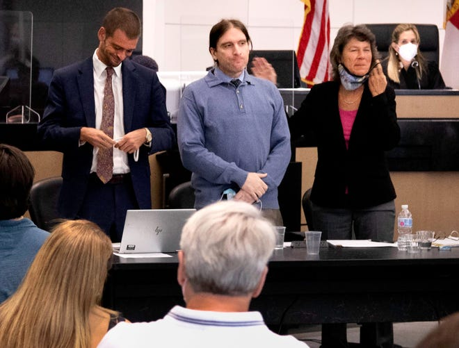 Jonathan Schuler stands between his defense attorneys as he is introduced to potential jurors by Public Defender Carey Haughwout Monday, August 30, 2021. Schuler is charged with murder in the February 2017 killing of Junior Petit-Bien in Boynton Beach, as well as two other murders in January and March of 2017.  Petit-Bien was shot 13 times; Schuler claims self-defense.