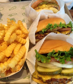 """Shake Shack, the national chain beloved for its thin, flavorful """"smash"""" griddled burgers, has locations in Boca Raton and Palm Beach Gardens."""