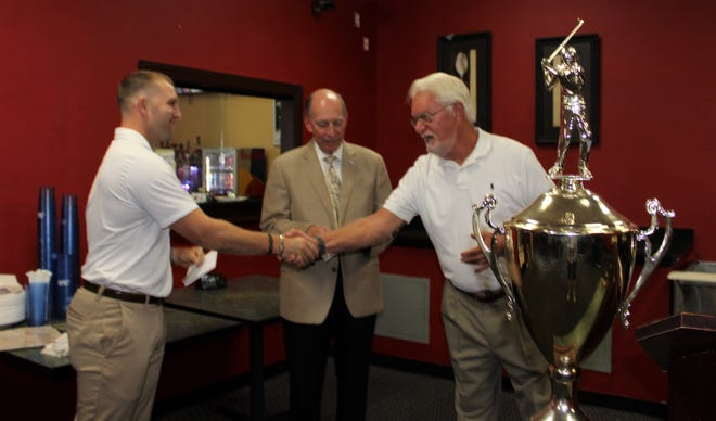 From left, VCU's Leadership Annual Giving Officer Christopher Mereen, Loyalty Automotive President Dave Perno, and Kiwanis Club of Colonial Heights member Charlie Townes participate in the check presentation to the Massey Cancer Center at Dante's Pizzeria & Grille in Colonial Heights on Aug. 25.