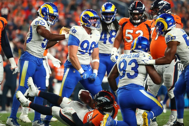 Rams defensive lineman Mike Hoecht (96), a former Brown University player, reacts after a tackle for a loss against the Denver Broncos during their preseason game on Aug. 28.