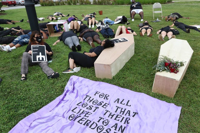 """Demonstrators stage a """"die-in"""" outside the Executive Office of Health and Human Services on Tuesday."""