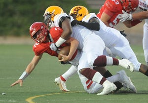 Lodi's quarterback Adam Schallberger is sacked by Edison defense during their game at the Grape Bowl Stadium in Lodi, Calif. Monday, Aug. 30, 2021.(Bea Ahbeck/Special to the Record)