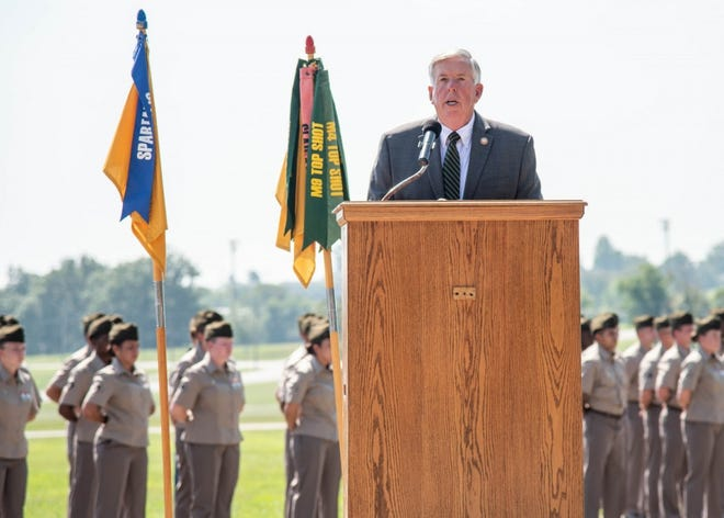 Missouri Governor Mike Parson visited Fort Leonard Wood Aug. 26, where he provided remarks at a Military Police One Station Unit Training graduation ceremony and then was honored with the Order of the Marechaussee in steel by Brig. Gen. Niave Knell, U.S. Army MP School commandant, for his service in the Army as an MP. (Photo by Dawn Arden, Fort Leonard Wood Public Affairs Office)