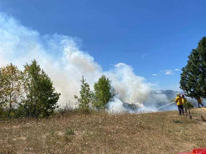 Firefighters respond to a brush fire in west Eugene.