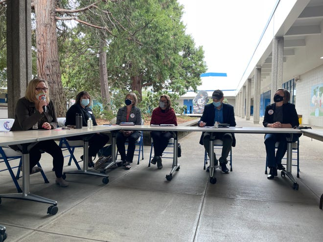 U.S. Sen. Ron Wyden, second from right, listens as Lane County and local school officials discuss the recent rise in mental health issues at Churchill High School in Eugene.