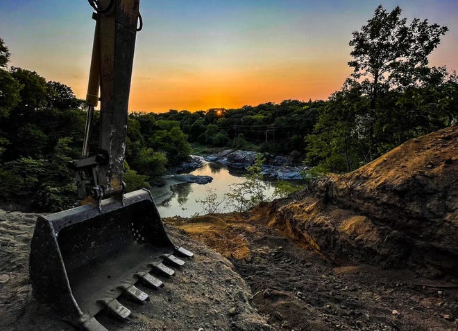 Earlier this summer Schmidt Construction was awarded the bid for the City of Redwood Falls' Power Plant Road Stabilization Project for $1,296,208. The contract calls for the work to be complete by Aug. 1, 2022. This view of the project highlights the beauty of the river versus the work of man.