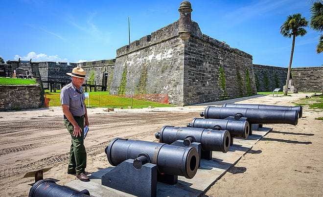 National Park Service Ranger Andrew Rich stands next to cannons returned to the Castillo de San Marcos in St. Augustine after being restored on Monday, Aug. 30, 2021.