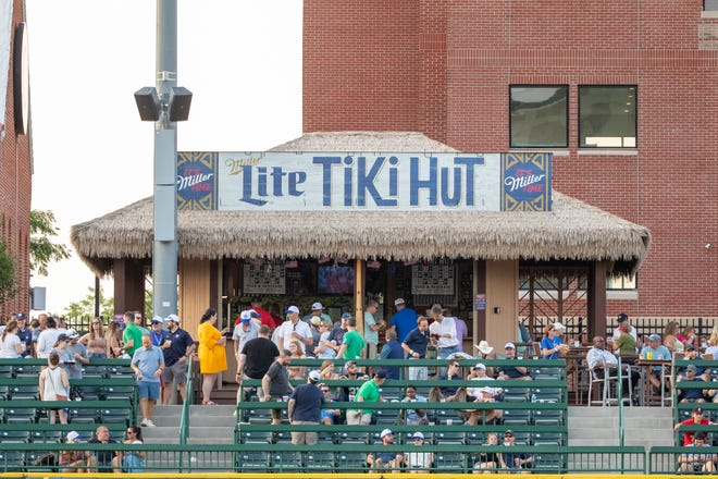 Fans enjoy the ball game and evening at the Tiki Hut during the South Bend Cubs-Wisconsin Timber Rattlers baseball game on Thursday, June 10, 2021, at Four Winds Field in South Bend, Indiana. The Cubs kick off their final homestand tonight at 7:05 p.m.