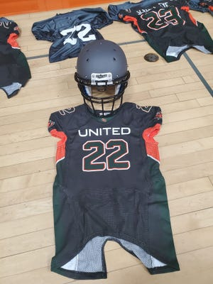 Pictured are the Sleepy Eye United football uniforms handed out to fifth and sixth graders on Aug. 23. Game Jerseys are a Dark Charcoal/Anthricite with Orange and Green accents. Each player also received a gray practice jersey, pads and a helmet.
