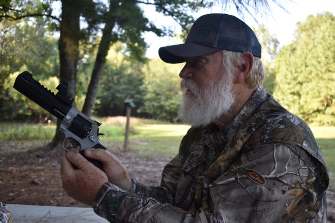 """Larry Weishuhn """"Mr. Whitetail"""" sighting in the .357 Taurus Raging Hunter that Luke will be doing some hunting with this fall."""