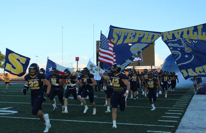 The Stephenville High School Yellow Jackets take the field for their season-opening game against Sweetwater on Friday at Tarleton's Memorial Stadium. The Jackets defeated the Mustangs, 51-13.