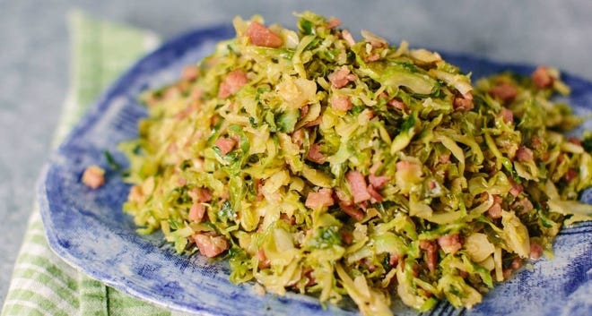 Brussels sprouts can be a polarizing ingredient, but slicing them thinly and cooking them with butter and salty country ham helps combat some of the natural bitterness.
