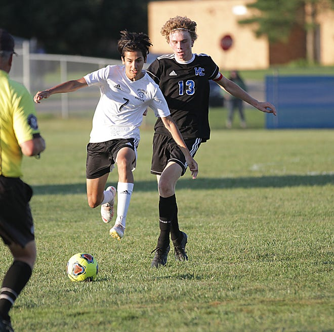 Jordan Lopez of Sturgis leaps his way toward a loose ball against Harper Creek on Tuesday evening.