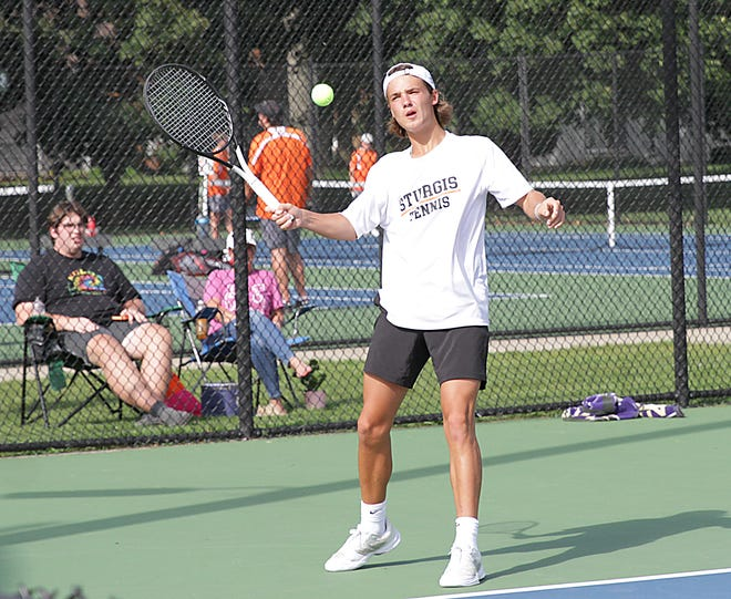 Matt Wynes of Sturgis returns a shot in his match at second singles on Monday afternoon.