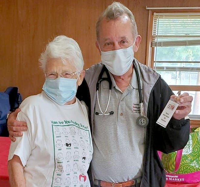 """""""Nurse Betty"""" Meyer, longtime nurse for the St. Joseph County Grange Fair, with Rick Shaffer, CEO of Covered Bridge Healthcare. A collaboration is underway to boost health offerings at the fairgrounds."""