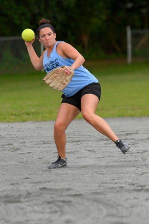 Bethany Rocha throws across the infield for a put out at first base during a recent Blooper Ball game between the Ms. Fits and Freetown Police at John Paun Park in Lakeville.