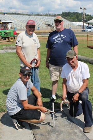 Horseshoe pitching winner Bobby Faidley (left), of Rockwood, won the annual horseshoe pitching contest at the Somerset County Fair on Saturday. He was followed by Carl Yoder (standing, left) of Hollsopple in second, Jim Romesberg Sr. (kneeling, right) of Garrett in third and Rick Wagner of New Alexandria in fourth. The contest was sponsored by Suter Beverage of Meyersdale.
