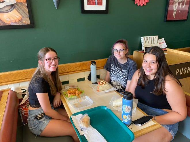 From Left, Sarah Medonca, Stephanie Stoevska and Mila Dofov stop in to Devito's Pizzeria for a quick bite on Aug. 27, 2021.