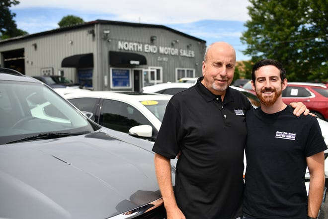 John Hadley with son Nick among inventory at North End Motors on Tuesday.