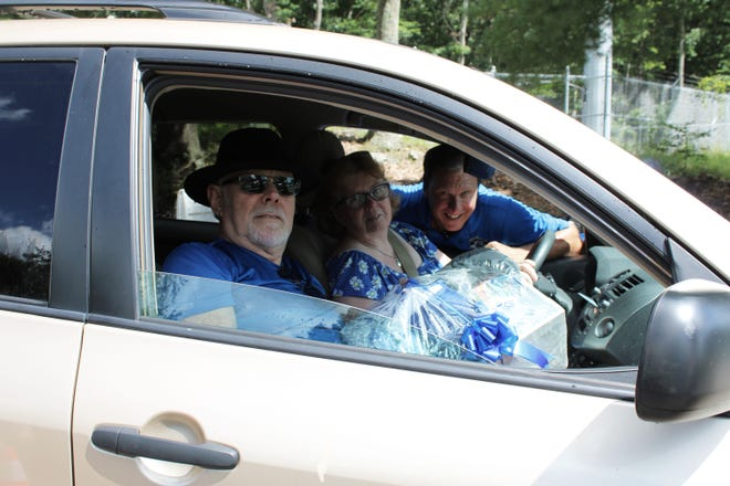 Jim Doherty, pictured with Worcester County Sheriff Lew Evangelidis and Elaine Weymoth, won a gift basket at the annual Sheriff's Senior Picnic held Aug. 21 at SAC Park in Shrewsbury.