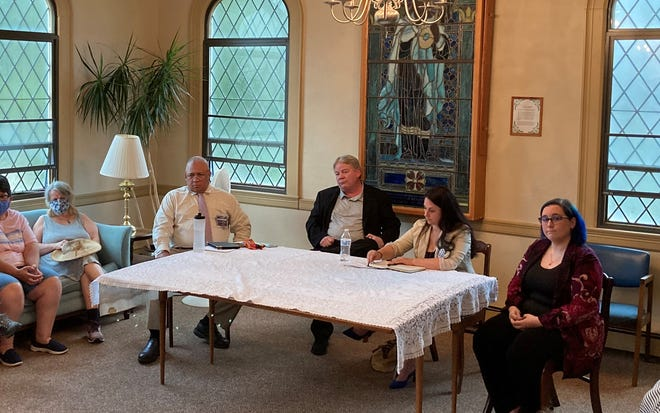 District 5 City Council candidates, from left, Gregory Stratman, Stephen Quist, Etel Haxhiaj and Yenni Desroches, participate in a forum for neighborhood groups Monday at First Congregational Church.