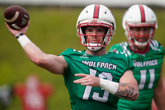 North Carolina State quarterback Devin Leary (13) passes during an NCAA college football practice in Raleigh, N.C., Wednesday, Aug. 4, 2021. (AP Photo/Gerry Broome)
