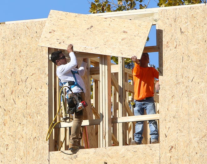 A construction crew works on a new apartment complex in Gainesville.