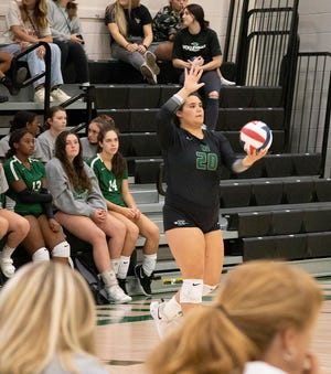 Waxahachie junior Emma Borders (20) gets ready to serve during the Lady Indians' home match against Mansfield Summit last week. The Lady Indians, fresh off a strong showing at Volleypalooza, were set to travel to Highland Park on Tuesday evening to face the No. 1-ranked team in Class 5A.
