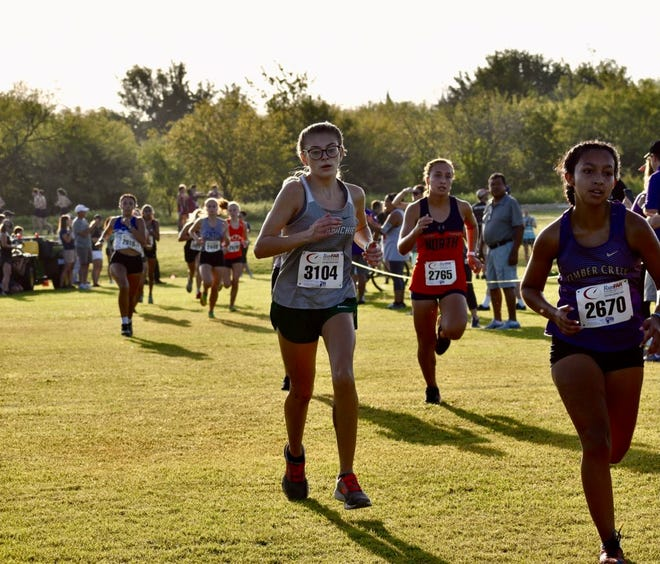 Waxahachie sophomore Whitley Blankenship (center) competes in the Southlake Carroll Invitational on Saturday. Blankenship ran a personal record of 21:44.51 and was the Lady Indians' No. 2 finisher.