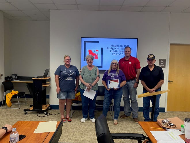 Members of the First Baptist Church of Maypearl who provide snack food for the weekends to several MISD students each week were recognized for their ministry which has averaged supplying food to 35 students for the past three years.  Those recognized were (left to right) Nikki Camp, Adele Mooney, Sherry Hodges, Board President Justin Stinson, and David Hodges. The recognition was during the regular monthly meeting of the Maypearl School Board on Thursday, Aug. 27. Also recognized were members of the Oaks Fellowship church who recently repainted the visitor-side stadium at W.G. Roesler field on the Maypearl campus.