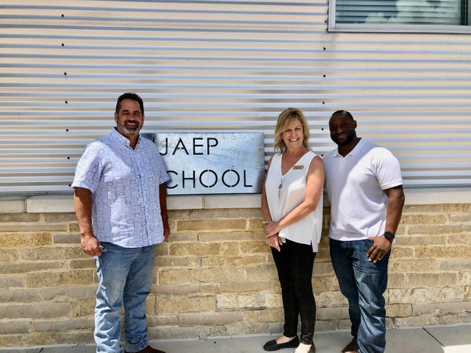 Non-profit organization Mentors Care recently announced a partnership with the Juvenile Justice Alternative Education Program of Ellis County. Pictured at the JJAEP facility located in Waxahachie are (left to right) Tom Moore, Chairman of the Board of Mentors Care; Dena Petty, Director and Founder of Mentors Care; and Darren Robinson, JJAEP Administrator.