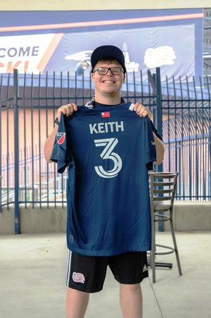 North Andover's Jimmy Keith proudly poses with his New England Revolution Unified jersey after signing a contract with the New England Revolution and Special Olympics Massachusetts to play for the 2021 Unified Team.