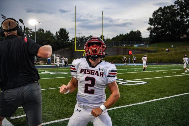 Pisgah quarterback Logan Free celebrates a touchdown during a 28-0 win at Enka on Monday, August 30, 2021.