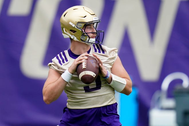 Washington Huskies quarterback Dylan Morris looks to pass during a preseason practice in Seattle. Washington begins the 2021 season as one of the favorites in the Pac-12 North Division, while also trying to erase the bad taste of how last year ended when a COVID-19 outbreak brought a sudden end to an already truncated schedule.