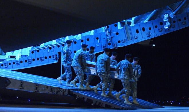 An Army carry team carries a transfer case containing the remains of Pfc. Paul O. Cuzzupe Tuesday, Aug. 10, 2010 at Dover Air Force Base, Del.