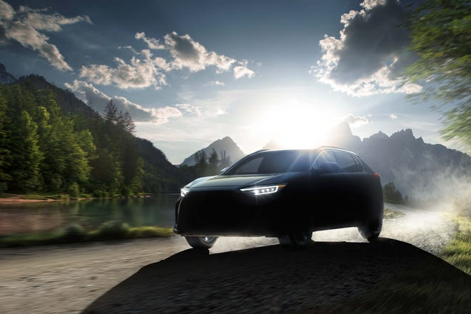 Subaru has teased this picture of its first EV, the Solterra SUV, co-developed with Toyota.