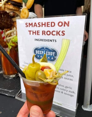 One of the bloody marys made by Smashed on the Rocks Saloon in Algoma that won first place in People's Choice voting at The Bloody Mary Festival held Aug. 21 in Milwaukee. The Smashed on the Rocks version also won second place from the festival judges for best original recipe and best garnish. In the background is an example of the loaded bloody marys the bar serves on weekends.