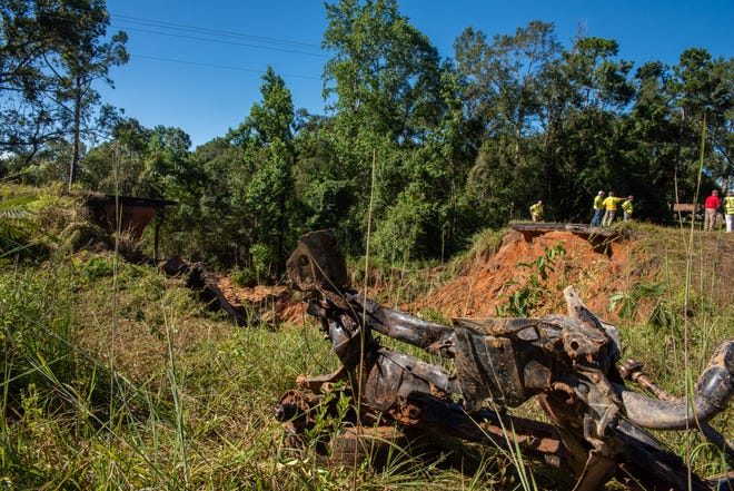 An axle from a vehicle that was dragged out of a massive hole on Highway 26 in Lucedale, Mississippi, on Tuesday, Aug. 31, 2021. Seven vehicles fell into the hole after part of the bridge collapsed late Monday night following heavy rain brought by Hurricane Ida.