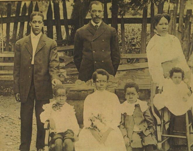 Photo of the Delaney Family, 1909 Top, left to right: Samuel Emery, John Samuel, Delia Bottom, left to right: Joseph, Ogust Mae, Beauford, Naomi
