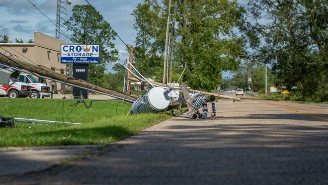 Downed powerlines are seen down across  Donaldsonville, Louisiana, after Hurricane Ida came through the region  Monday, Aug. 30, 2021.