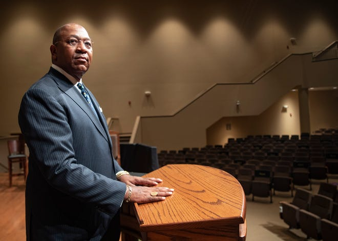 Rev. Keith Norman poses for a portrait inside the sanctuary at First Baptist Church- Broad on Tuesday, Aug. 31, 2021. New precautions will be set in place following a surge of new infections due to the delta variant.