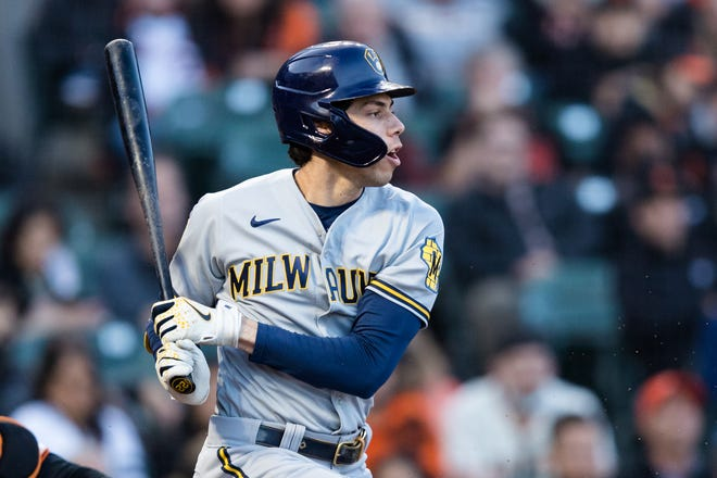 Christian Yelich hits an RBI single in the second inning Monday night against the Giants. The former two-time National League batting champion and 2018 NL MVP is starting to heat up as the Brewers enter September.