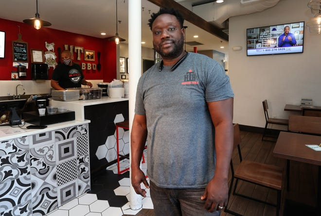 Jason Alston, shown at his Heaven's Table BBQ stall at Crossroads Collective food hall, 2238 N. Farwell Ave., plans to open a second restaurant at 5507 W. North Ave. in late September or so. It will have barbecue and also some Jamaican fare. Alston in April received a pardon from Gov. Tony Evers stemming from drug charges in 2000.