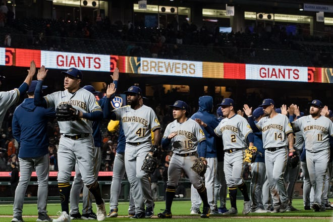The Brewers celebrate a victory over the Giants on Monday night that gave them 80 wins for the season and a 9½-game lead over the second-place Reds in the NL Central.