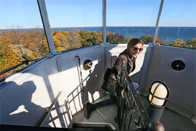 Patricia Algiers of Shorewood climbs the North Point Lighthouse tower as part of a tour on Oct. 18, 2015.