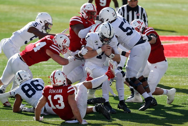 The Nebraska defense swarms Penn State quarterback Will Levis in an embarrassing loss by the Nittany Lions last season.