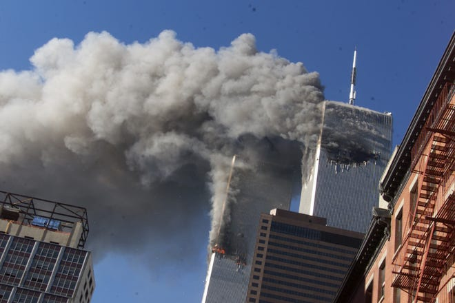FILE - This Sept. 11, 2001 file photo shows smoke rising from the burning twin towers of the World Trade Center after hijacked planes crashed into the towers, in New York City. The U.S. government is aware of no credible or specific information that points to any terror plot tied to the anniversary of the September 2001 attacks, according to a new confidential threat assessment from the FBI and Homeland Security Department obtained by The Associated Press.  (AP Photo/Richard Drew, File) ORG XMIT: WX103