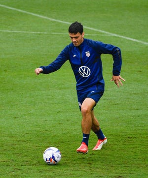 Christian Pulisic dribbles the ball during practice at Lipscomb Academy  in Nashville, Tenn., Tuesday, Aug. 31, 2021.
