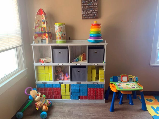 The children's toy room is completely organized in an orderly fashion at the Healing House.