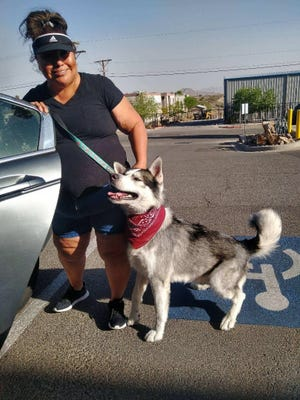 Graciela Rodriguez and her 3-year-old Malamute named Thor hold for a picture after leaving a dog spa earlier this year.